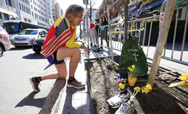Ron McCracken of Dallas pays his respects at a makeshift memorial honoring to the victims ...
