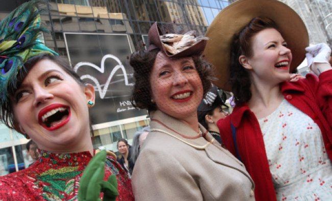 Dressed for the occasion, Ella Morton, right, and others pose for photographs along New York\'s ...