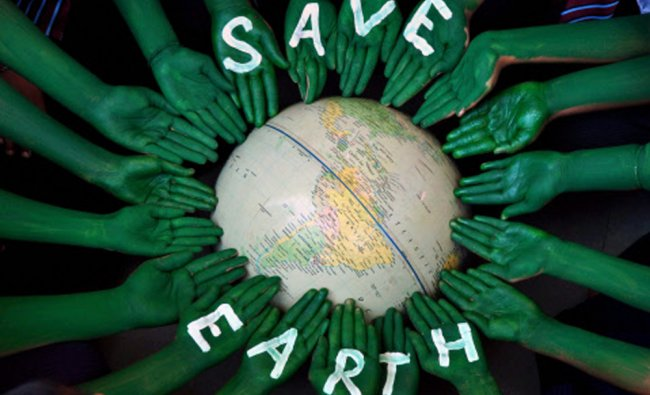 Students taking part in an awareness programme on the eve of World Earth Day in Patiala...