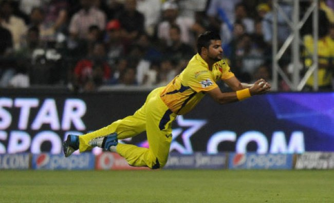 Suresh Raina of the Chennai Superkings dives to take a catch to get the wicket of Mayank...