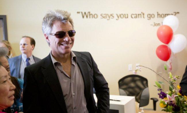 Jon Bon Jovi walks through the lobby of the JBJ Soul Homes during the grand opening, Tuesday ...