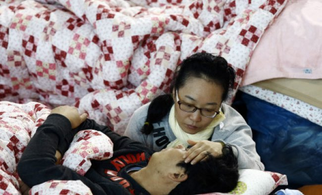 Family members of a missing passenger of capsized passenger ship Sewol which sank last ...