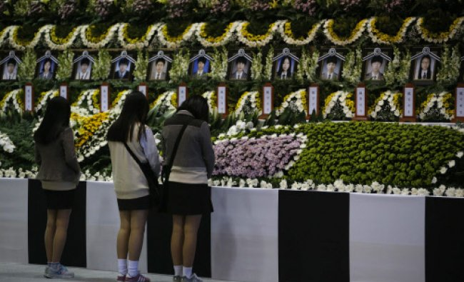 Students from Danwon high school pay tribute in Ansan, at a temporary group memorial altar ...