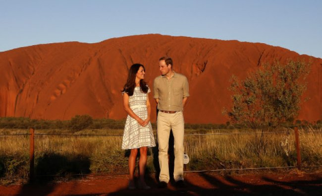 Britain\'s Prince William and his wife Catherine, Duchess of Cambridge, pose in front of the Uluru...