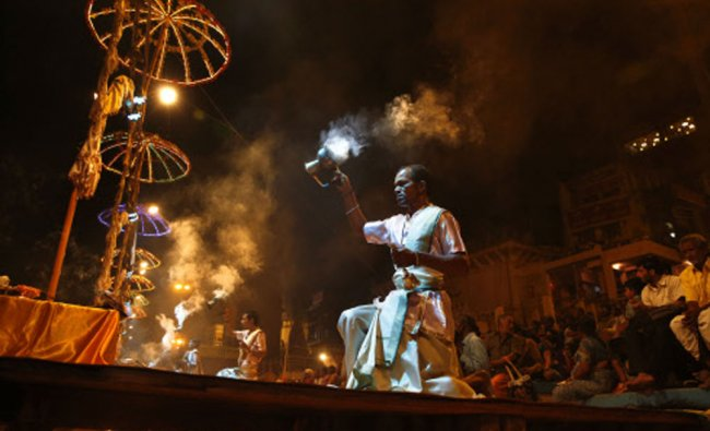 Indian devotees pray and take dip on the banks of the river Ganges, in Varanasi...