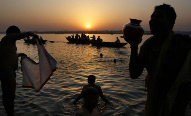An Indian Hindu devotee prays to the river Ganges, in Varanasi, India...