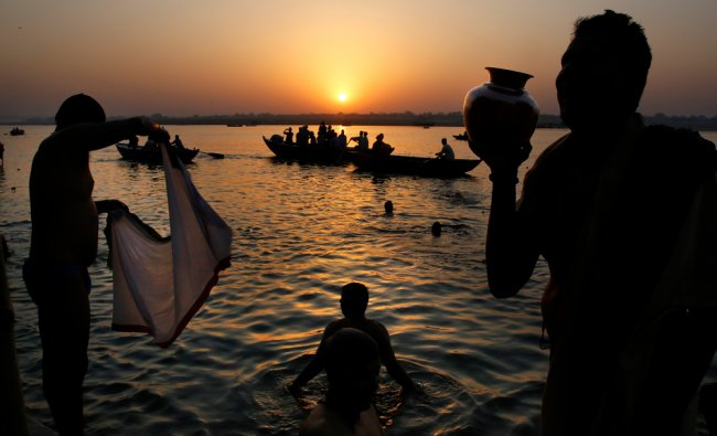 Devotees pray and take dip on the banks of the river Ganges, in Varanasi. AP Photo