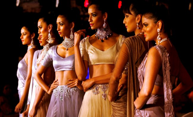 Models walk the ramp displaying jewellery during a fashion show in Chandigarh on Wednesday...