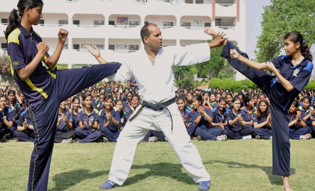 Girls learn martial arts during a self defense training camp in Faridabad on Wednesday. PTI Photo