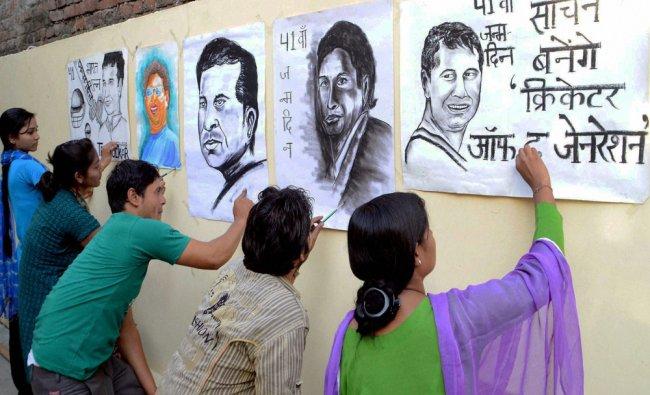 Artists make paintings of Sachin Tendulkar to wish him on the eve of his birthday in Moradabad...