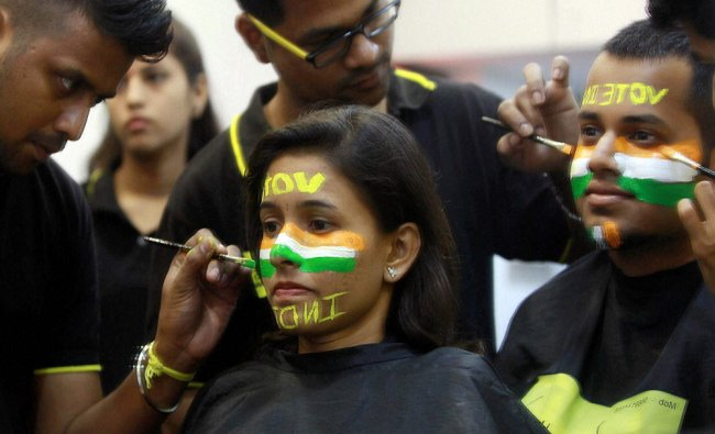 People get their face painted to create awareness on importance of voting in Mumbai on Wednesday...