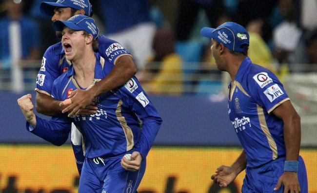 Abhishek Nayar of the Rajatshan Royals , Stuart Binney and Steve Smith celebrate the wicket of ...