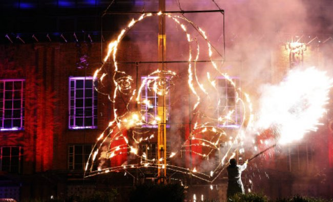 A pyrotechnician lights a flaming depiction of William Shakespeare during a firework display ...