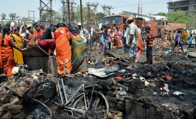 Residents trying to salvage their belongings after a massive fire gutted their houses in Patna...