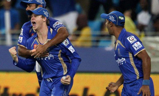 Abhishek Nayar of Rajatshan Royals , Stuart Binney and Steve Smith celebrate the wicket of Brendon..