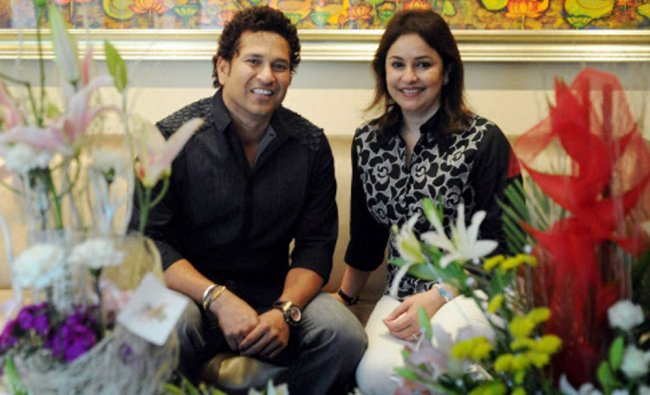 Sachin Tendulkar poses for a photograph with his wife Anjali during his 41st bithday celebrations...