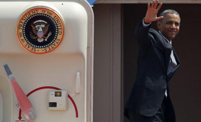 U.S. President Barack Obama waves from Air Force One as he departs Haneda International Airport...