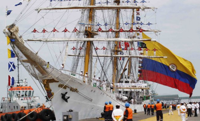 Crew members of Colombian-registered sailing ship Gloria stand on the ship\'s masts during a...