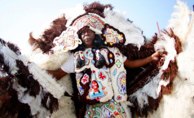 A Mardi Gras Indian parades during the first day of the New Orleans Jazz and Heritage Festival ...