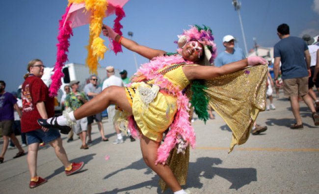 Jennifer Jones of New Orleans parades during the first day of the New Orleans Jazz and Heritage ...