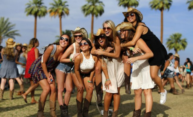 Country music fans pose during the first day of the Stagecoach country music festival ...