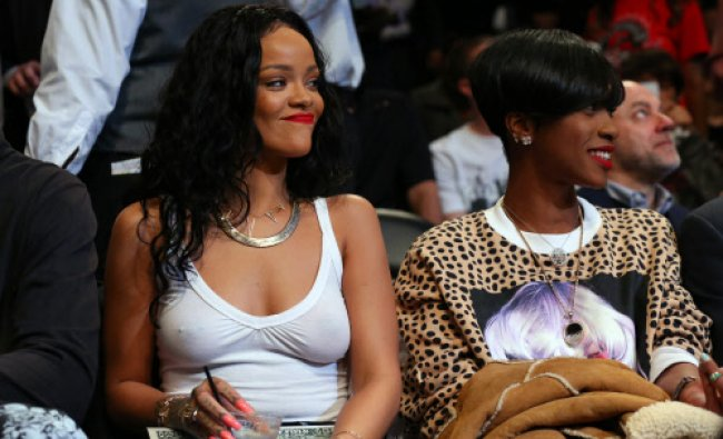 Recording artist Rihanna sits court side at the game between ...