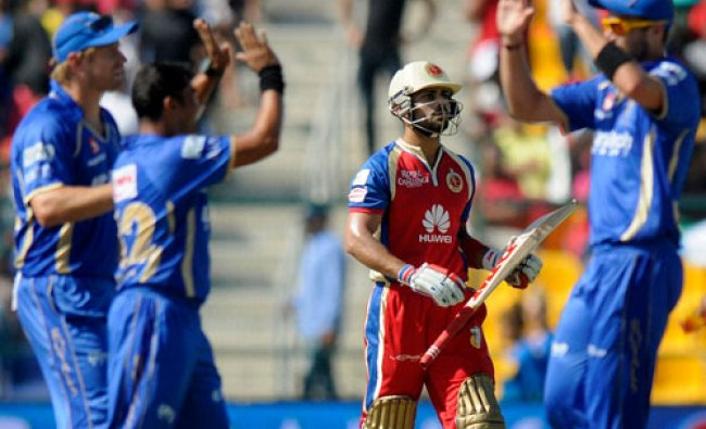 Virat Kohli captain of the Royal Challengers Bangalore walks back after getting out during an...