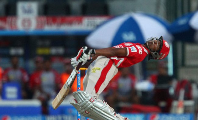 Kings XI Punjab\'s Wriddhiman Saha avoids a delivery from Morne Morkel of the Kolkata Knight...