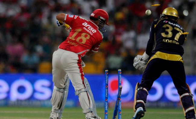 Virender Sehwag of the Kings X1 Punjab gets bowled out by Piyush Chawla of the Kolkata Knight...