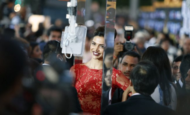 Indian film star Deepika Padukone walks the green carpet as she arrives for the 15th annual ...