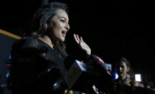 Indian film star Sonakshi Sinha walks the green carpet as she arrives for the 15th annual ...