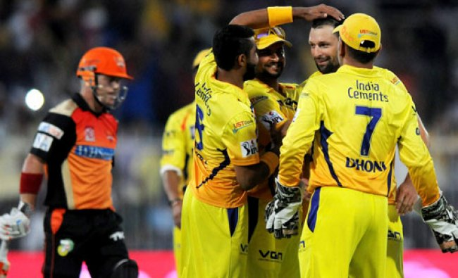 Ben Hilfenhaus of The Chennai Superkings celebrates the wicket of David Warner of the Sunrisers...