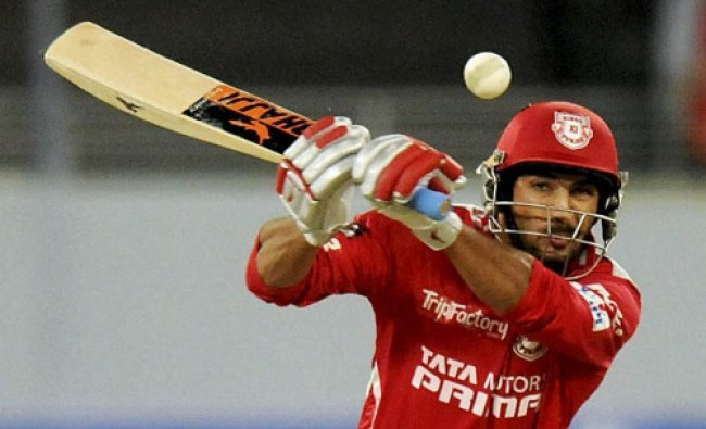 Rishi Dhawan of the Kings X1 Punjab bats during during an IPL 7 match against Royal Challengers ...