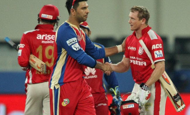 George Bailey of the Kings X1 Punjab and Yuvraj Singh of the Royal Challengers Bangalore ...