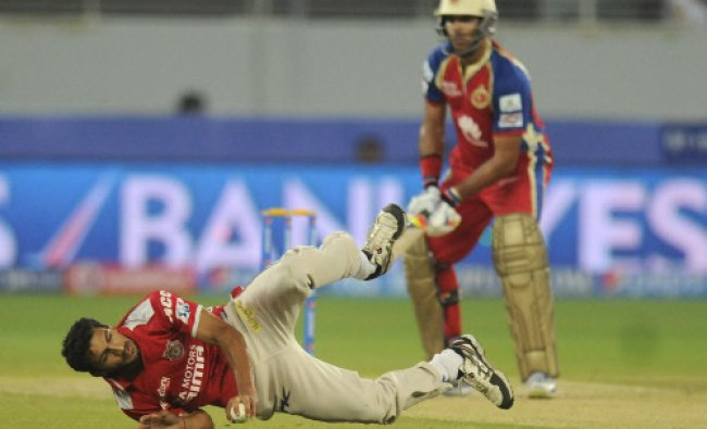 Kings X1 Punjab\'s Rishi Dhawan fields during a T20 match against Royal Challengers Bangalore ...