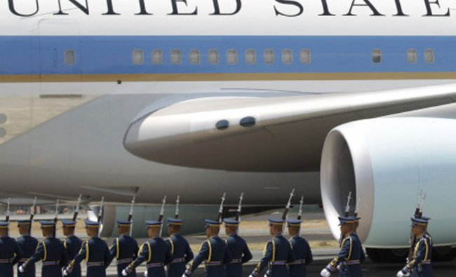Filipino soldiers march towards Air Force One as they prepare departure honors for U.S. President...