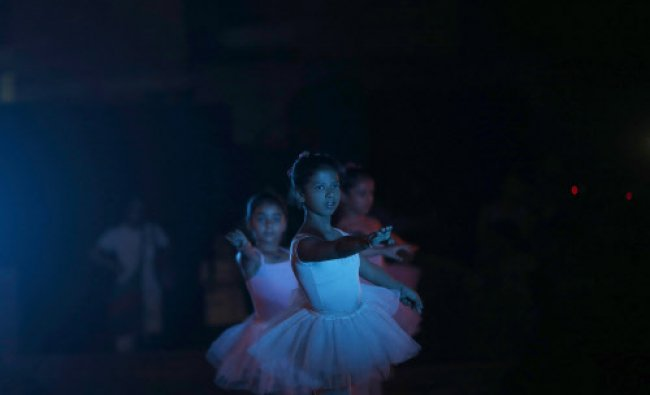 Ballet dancers perform as they celebrate International Dance Day, in New Delhi...