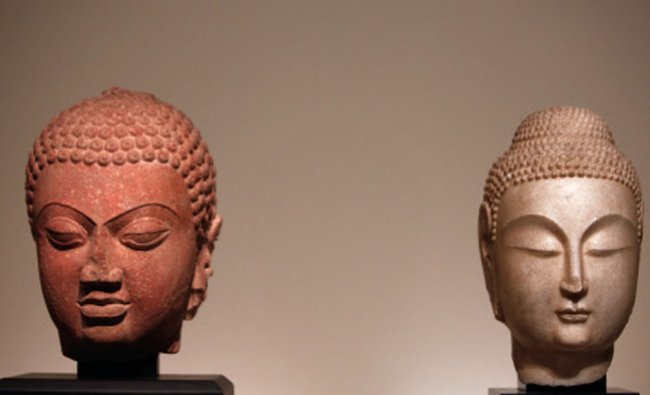 Buddha Heads from Northern China (534-550 bc), and India, displayed as part of the exhibition...