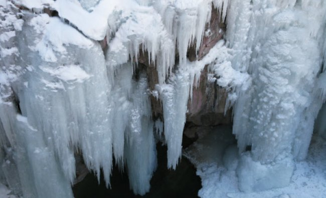 This Jan. 18, 2014 photo shows a chandelier-like formation in the Ouray Ice Park in Ouray, Colo....