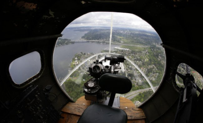 Lake Washington is viewed from the front gun turret of a Boeing B-17 \'Flying Fortress\' bomber...