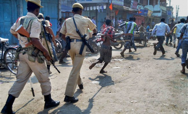 Policemen lathi charge bandh supporters during a protest against the killings in BTAD areas ...
