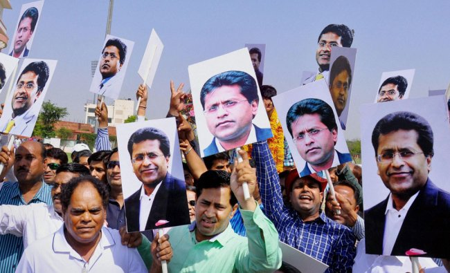 Supporters celebrate as Lalit Modi was declared the President of Rajasthan Cricket Association ...