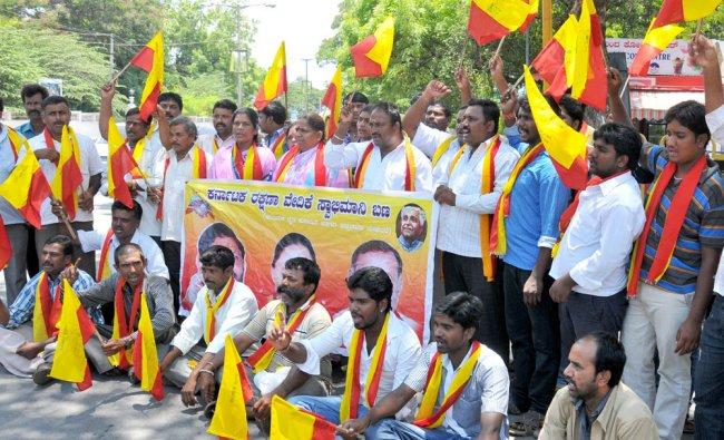 Karnataka Rakshana Vedike stages a protest against the hike in bus fare, in Mysore ...