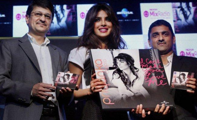 Bollywood actress Priyanka Chopra with Viral Oza, Marketing Director, Nokia India during...