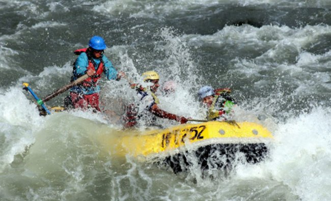 Tourists enjoying water sports in Beas River in Manali on Tuesday...