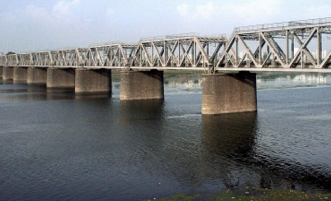 A view of a historical railway brige which is about to complete its 100 years, in Surat on Tuesday..