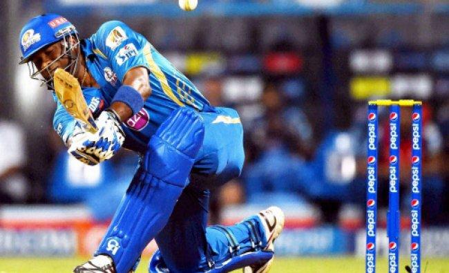 Kieron Pollard of the Mumbai Indians bats during an IPL 7 match against Royal Challengers...