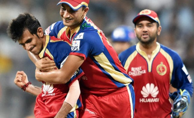 Royal Challengers Bangalore players celebrate wicket during an IPL 7 match against Mumbai Indians...