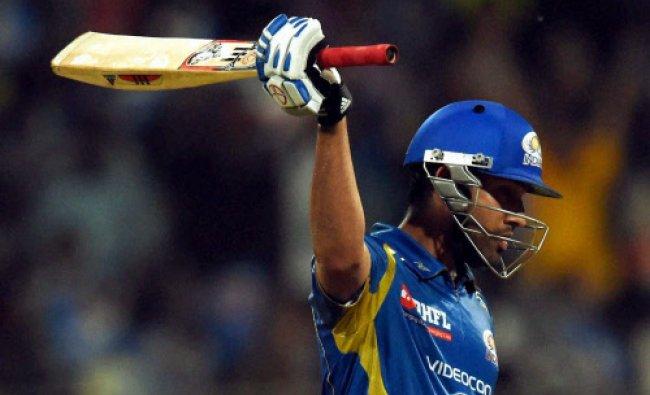 Rohit Sharma of the Mumbai Indians raises his bats after scoring a half century during an IPL 7...