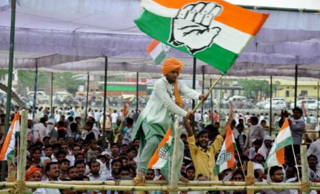 A supporter waves a Congress party flag during party Vice president Rahul Gandhi\'s election...